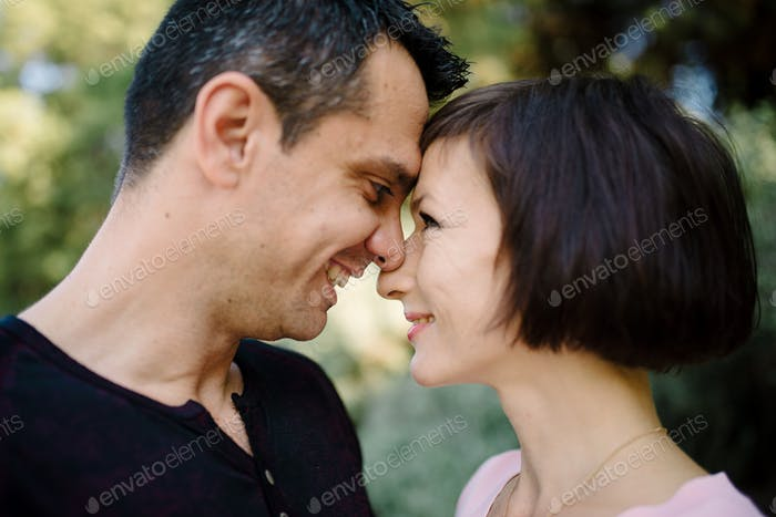 Couple in love romantic date nature park background.