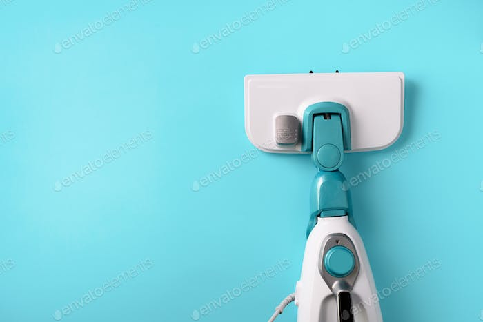 Steam cleaner mop on blue background. Top view, flat lay. Banner with copy space. Cleaning service