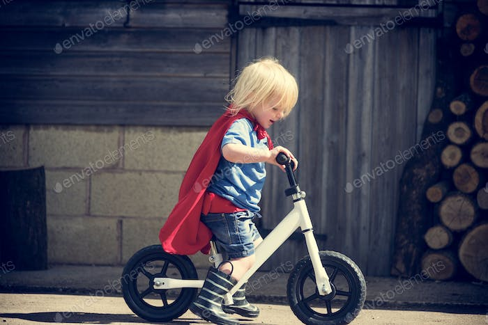 Superhero Baby Boy Ride Bicycle Adorable Concept