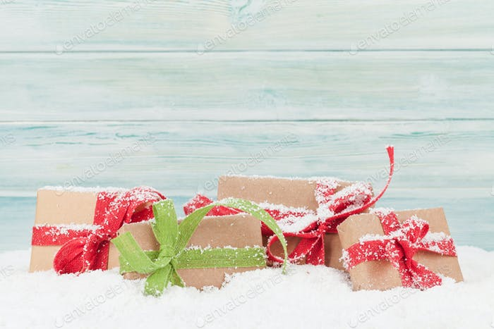 Christmas card with gift boxes in snow