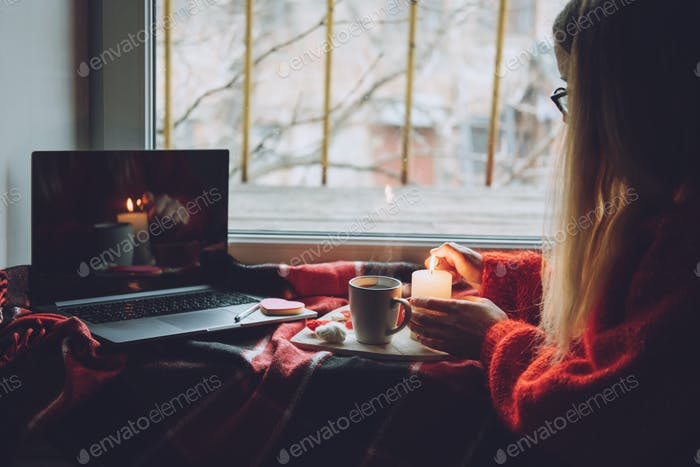 Woman using online dating app on laptop. Valentines Day, dating, meeting During The Coronavirus