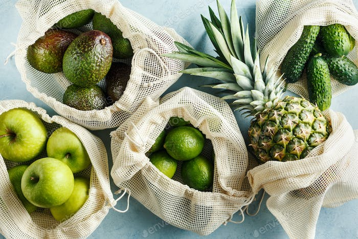 Organic green vegetables and fruits in reusable bags
