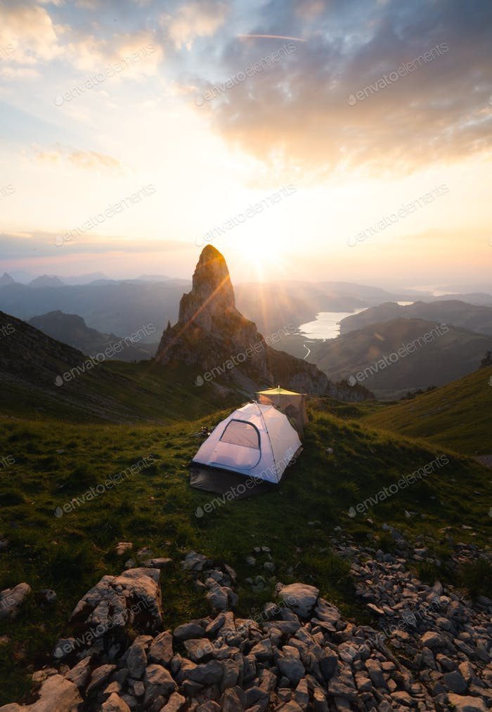 Tent on a Mountain in Switzerland during Sunset