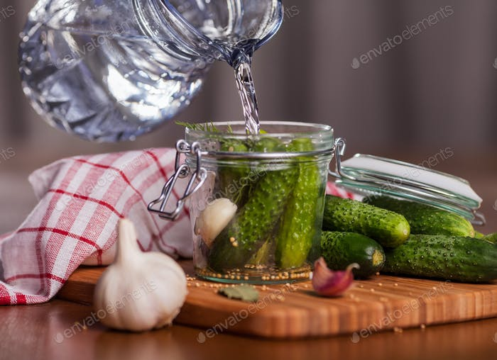 Preparing pickle cucumbers in the kitchen