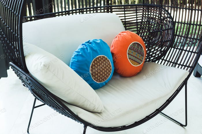 Multicolor round pillows on sofa