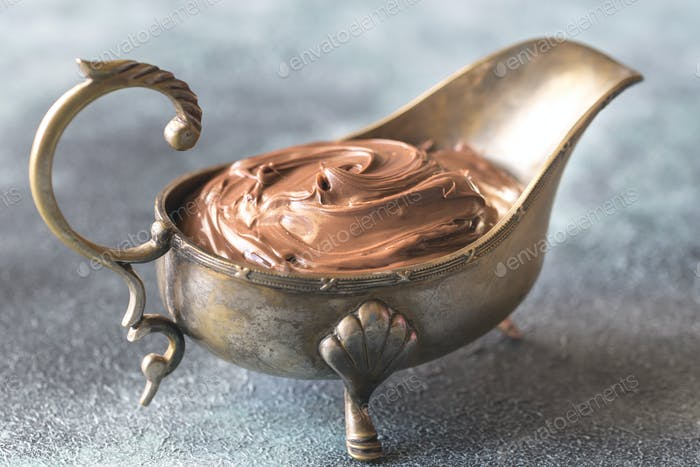 Vintage gravy boat with chocolate cream