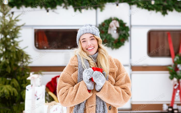 Winter Portrait Of Beautiful Blonde With Red Coffee Mug In Hands