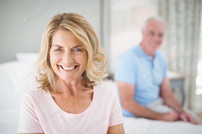 Portrait of senior woman smiling in bedroom