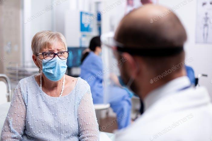 Looking worried at doctor