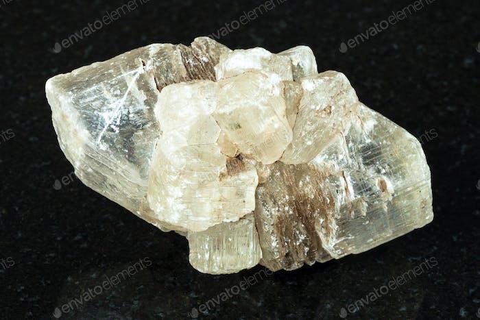 greenish rough Fluorite crystals on black