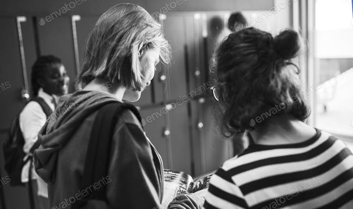 Students with friends at lockers room