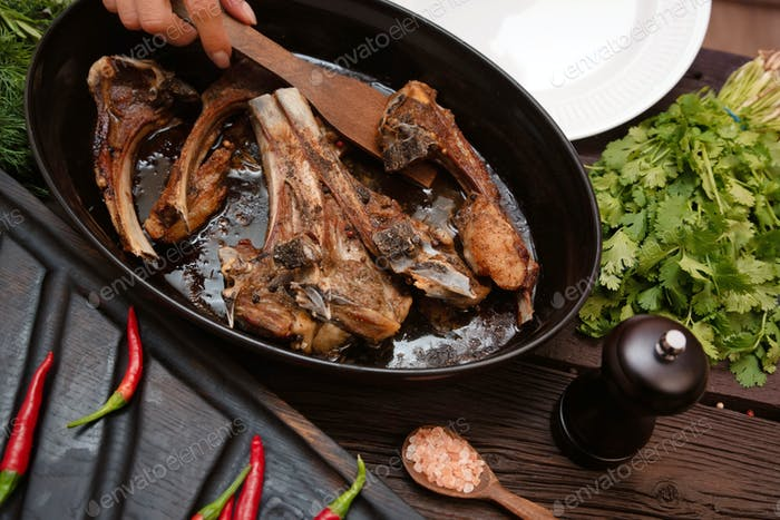 Roasted lamb ribs on frying pan close