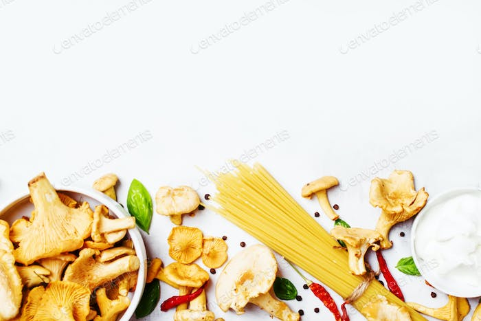 Ingredients for cooking pasta with mushrooms chanterelles in a creamy sauce
