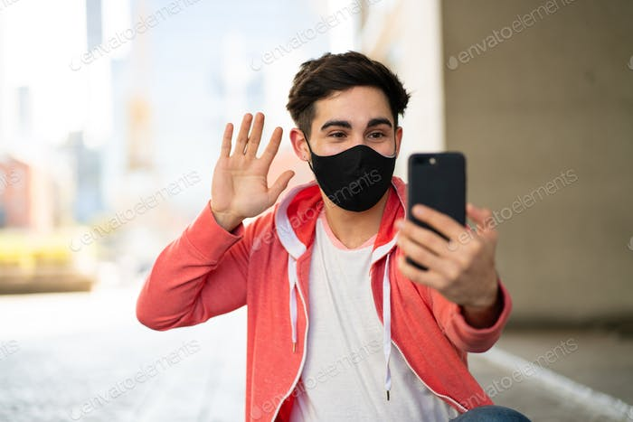 Young man having a video call on mobile phone.