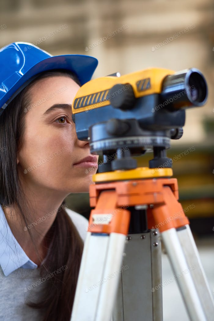 Concentrated young female builder