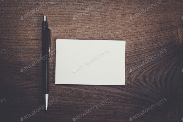 blank notebook and pen on the table