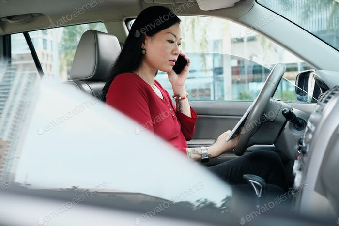 Business People Working In Car And Talking On Cell Phone