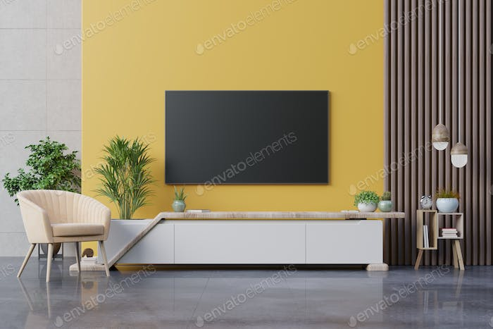 Living room led tv on yellow wall with armchair and cabinet tv on yellow wall background.