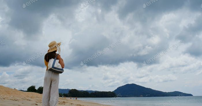 Woman look at the sea on beach