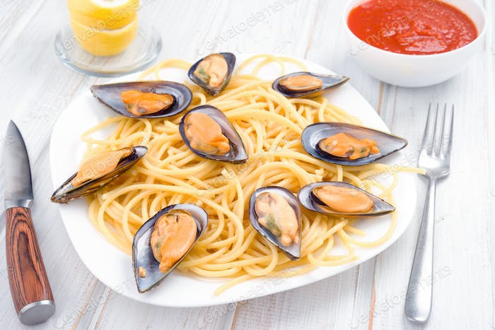 Italian pasta with Galician mussels in white wood, approach