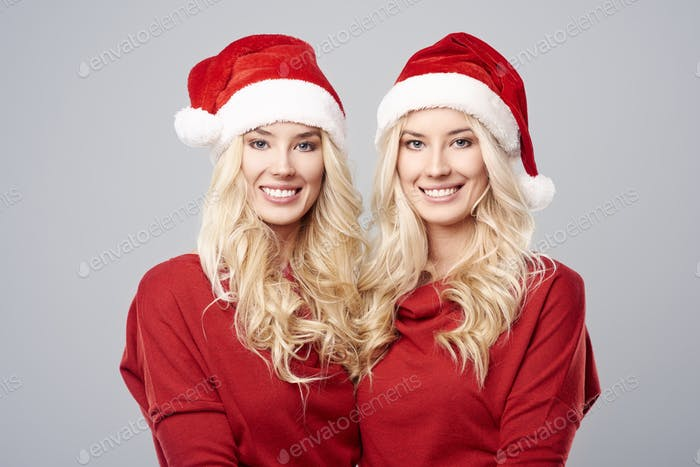 Winter twins in santa hats