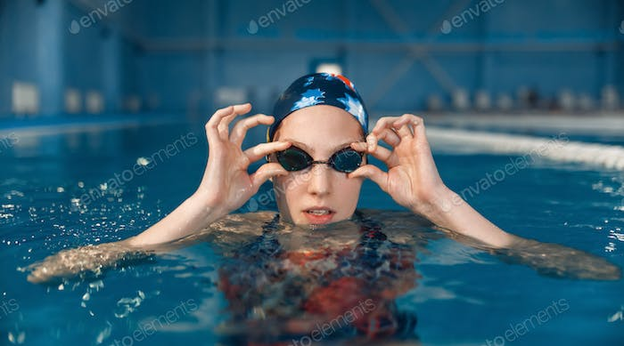 Female swimmer in pool, woman at the poolside