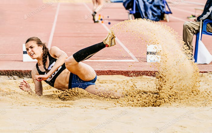woman long jump in track and field
