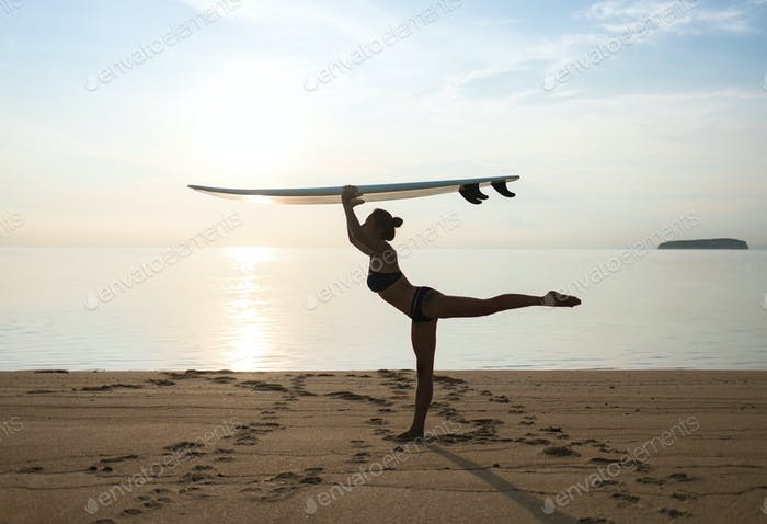 graceful storty girl or young woman keeping balance