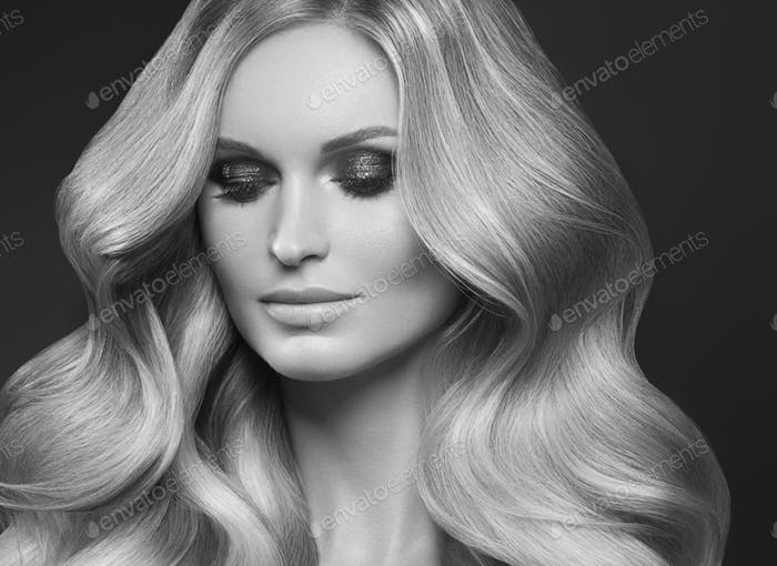 Healthy curly hair woman long blonde hairstyle female. Monochrome. Gray. Black and white.