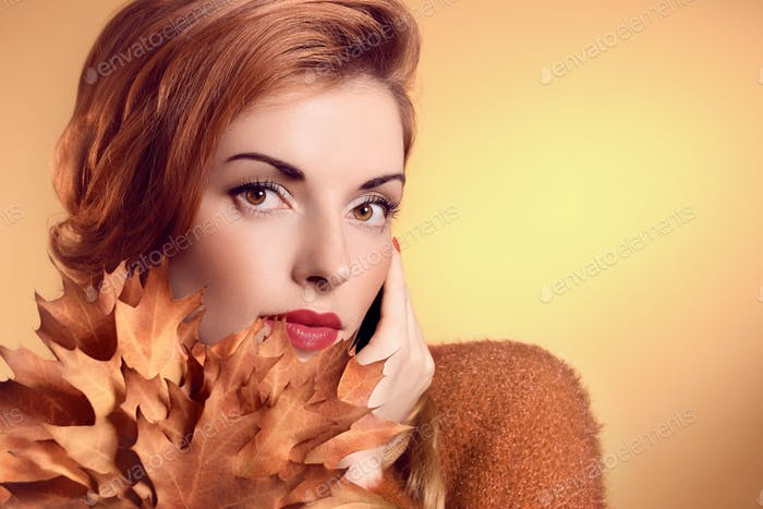 Beauty redhead, autumn leafs