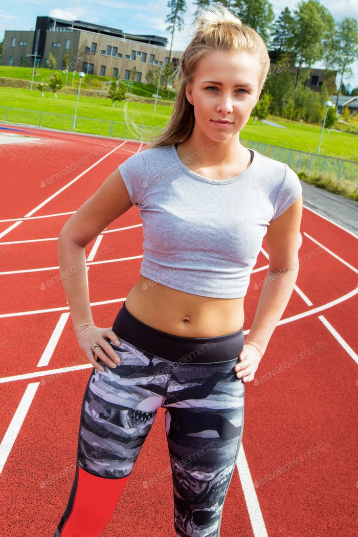 Close-up of a Runner Standing With Hands On Hips On Running Tracks