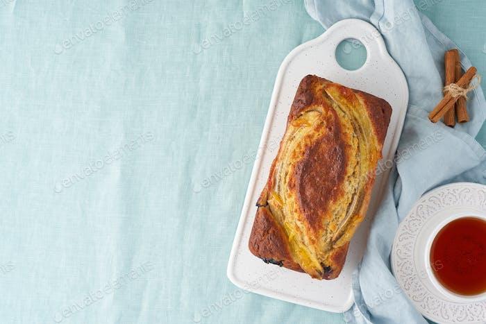 Banana bread, cake with banana. Whole loaf on cutting board