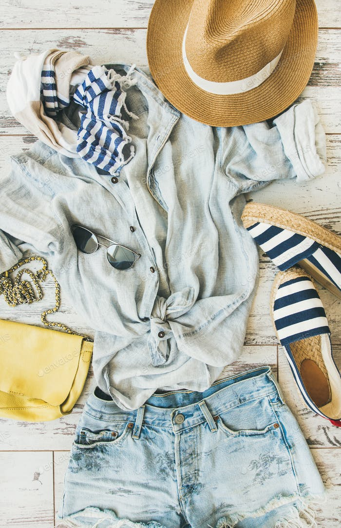 Summer woman's outfit flatlay, top view, vertical composition