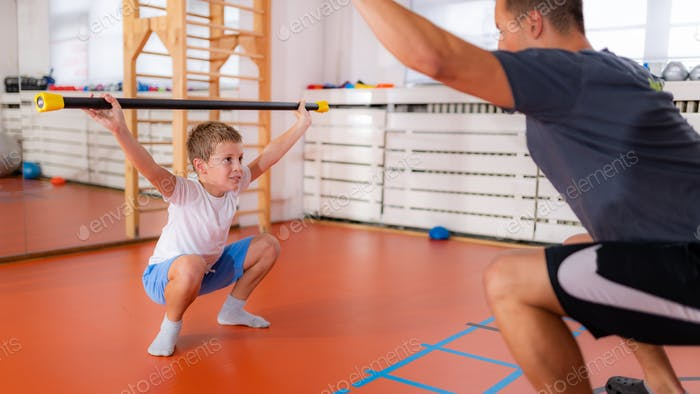 Squats with a bar, strength training and exercise for children