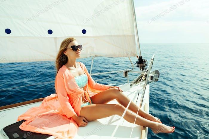sexy girl in swimwear pareo on yacht sea cruise vacation