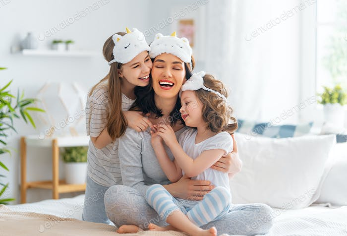 girls and their mother enjoying sunny morning