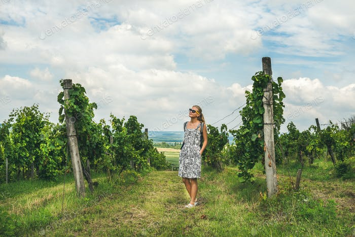 Young woman standing at Tihany wineyards, Hungary