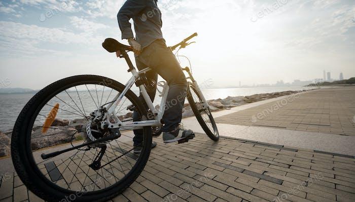Riding bike on seaside city
