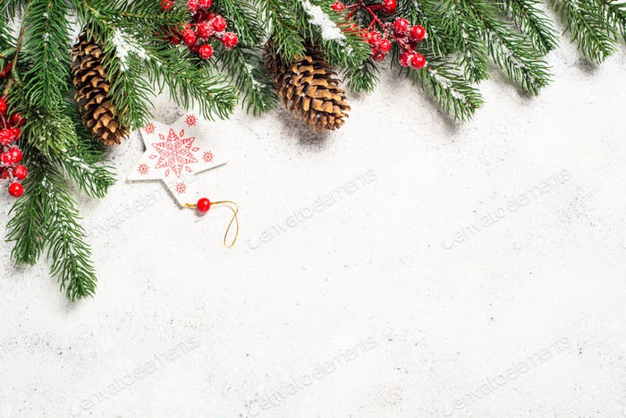 Christmas background with fir tree and decorations on white bac