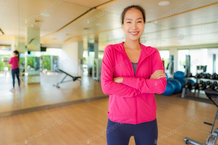 Portrait asian woman exercising and work out in gym