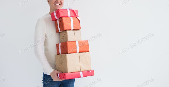 Christmas and holidays concept - Close up of man with many gifts on white background with copy space
