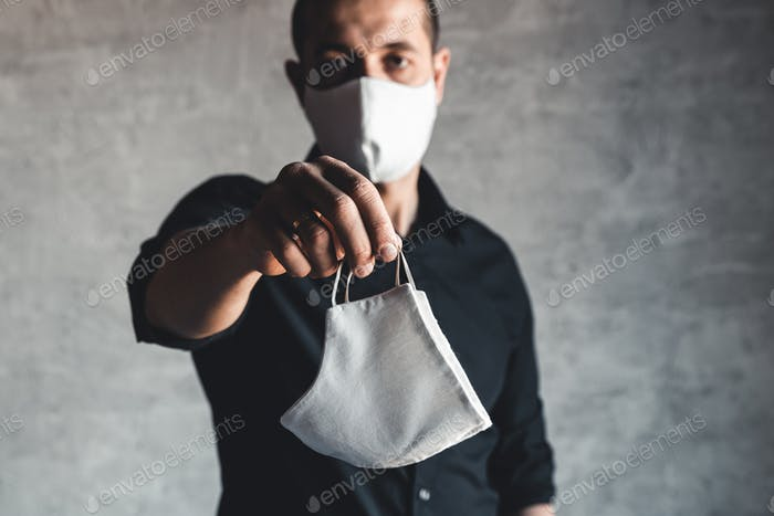 Epidemiologist offering protective respiratory mask in coronavirus concept, selective focus