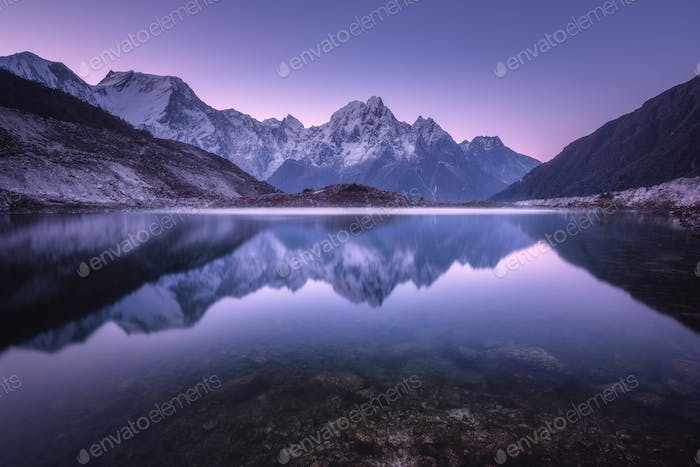 Mountain lake with perfect reflection at sunrise