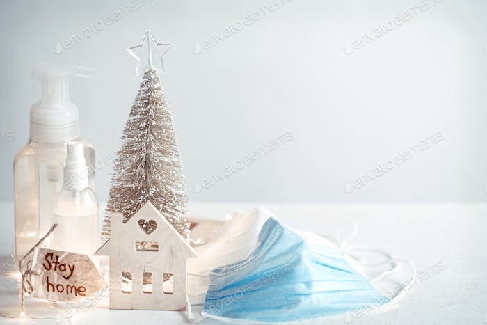 Christmas background with coronavirus personal protective equipment and decor details copy space.