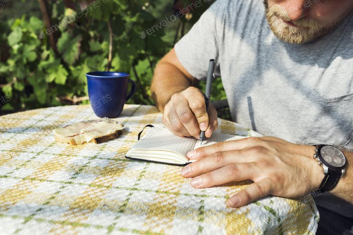 Man taking notes on table