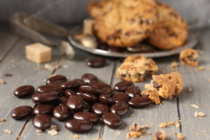Chocolate candy with chocolate chip cookies on wooden background