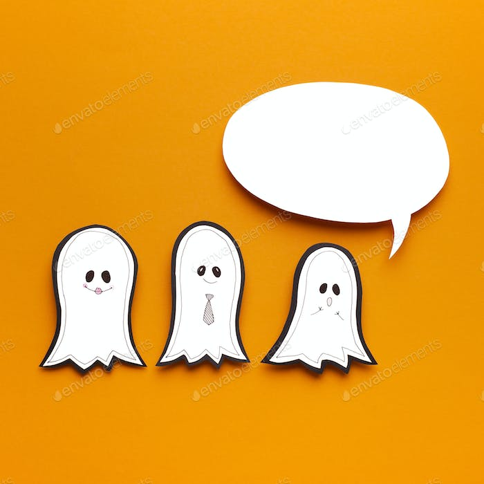 Halloween orange background with three funny paper silhouettes