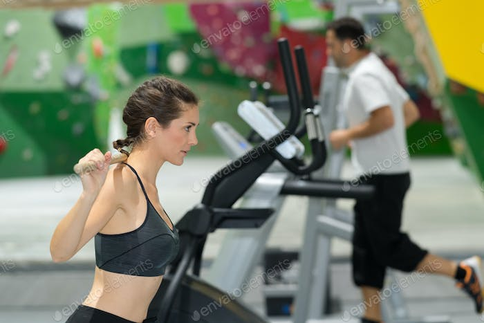Lady exercising in fitness center