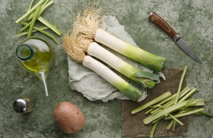raw leeks and borage, on a marbled green background