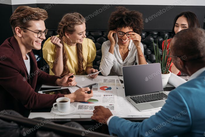 group of business colleagues working together in cafe